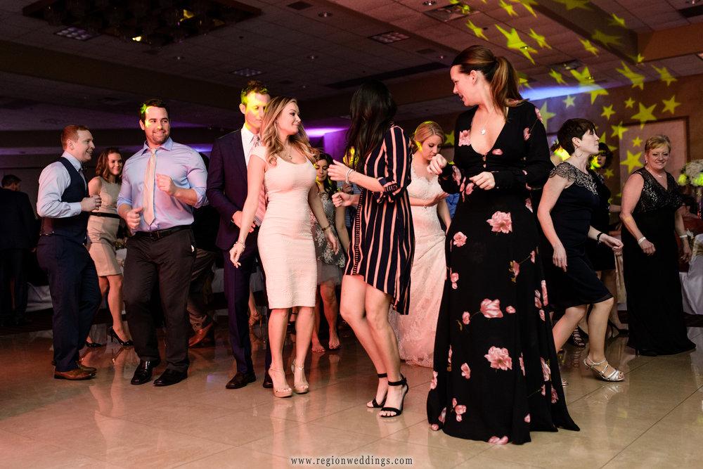A full dance floor at Villa Cesare during a winter wedding reception.