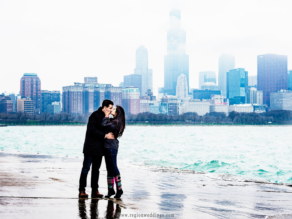 Fog engulfs the Chicago Skyline as a newly engaged couple embraces.