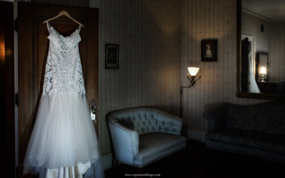 The elegant dress from Paris House of Bridal hangs in the bridal suite.