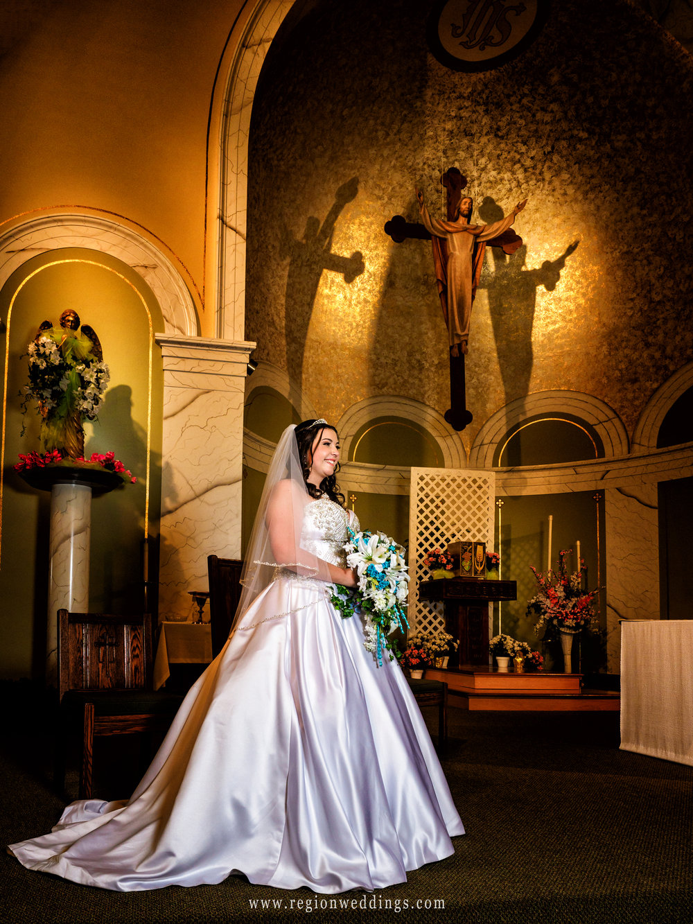 The bride on the altar of Holy Name Catholic Church in Cedar Lake, Indiana.