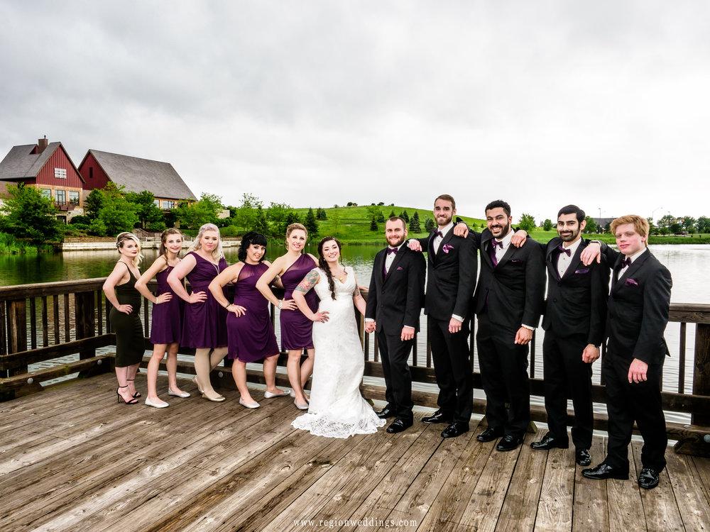 Wedding party photo on the lake bridge at Centennial Park.
