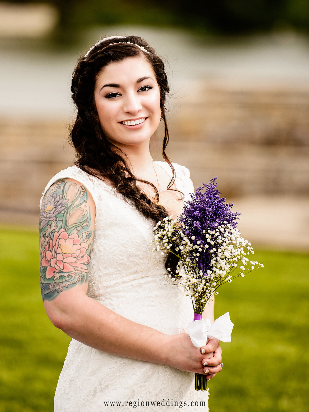 The beautiful bride and her purple flowers.