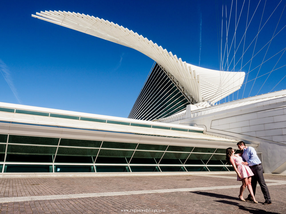 A romantic dip at the entrance of the Milwaukee Art Museum.