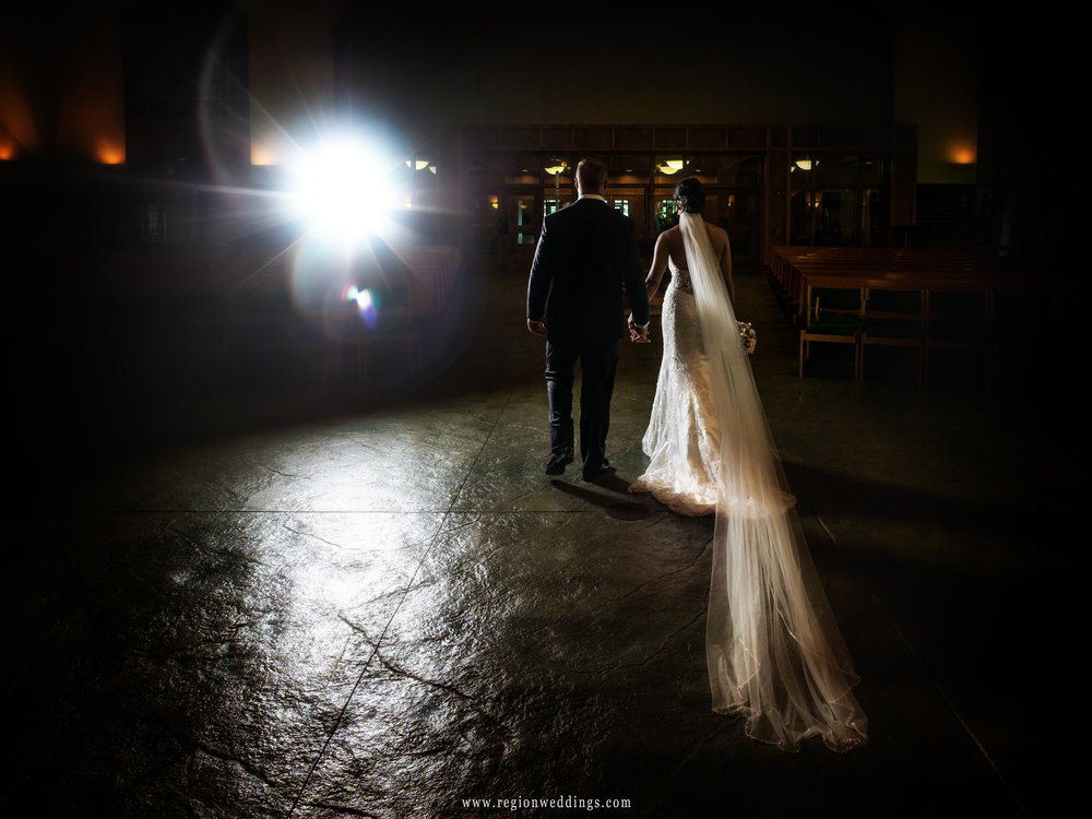Bride and groom exit the darkened St. Michael's Church.