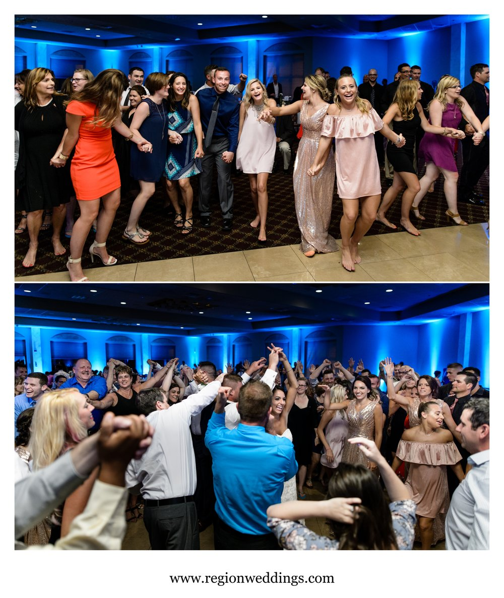 A crowded dance floor at Villa Cesare for a June wedding reception.