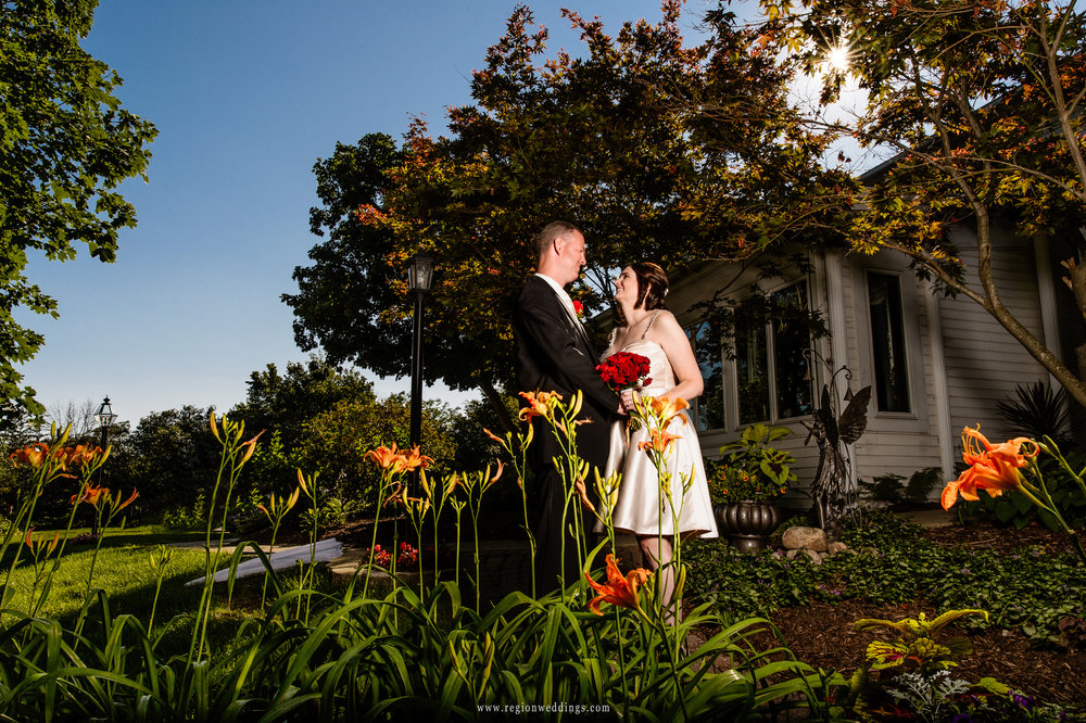 Bride and groom at the garden entrance of The Inn At Aberdeen in Valparaiso, IN