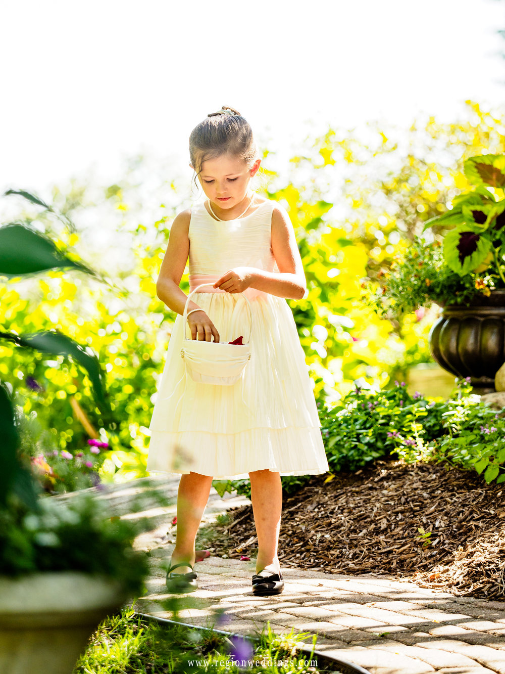 Flower girls fills the pathway with petals at The Inn At Aberdeen.