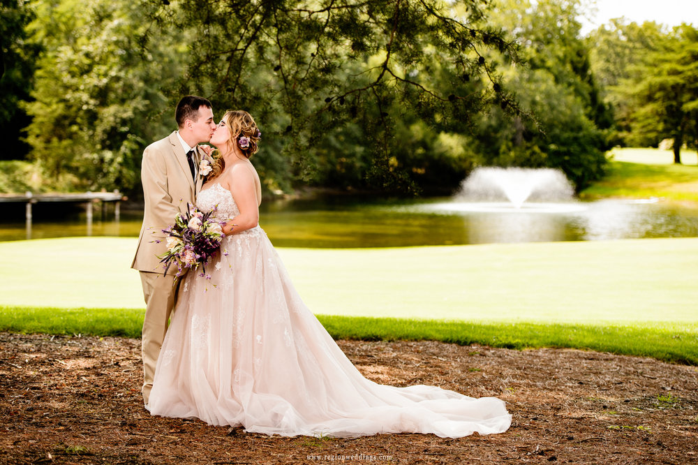 Bride and groom on the golf course at The Pavilion at Sandy Pines in Demotte, Indiana.