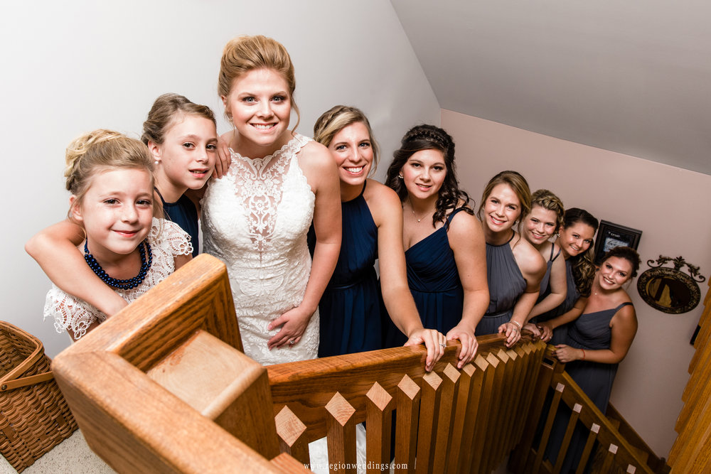 The bridesmaids on the stairs leading to the loft of the bride's childhood home.