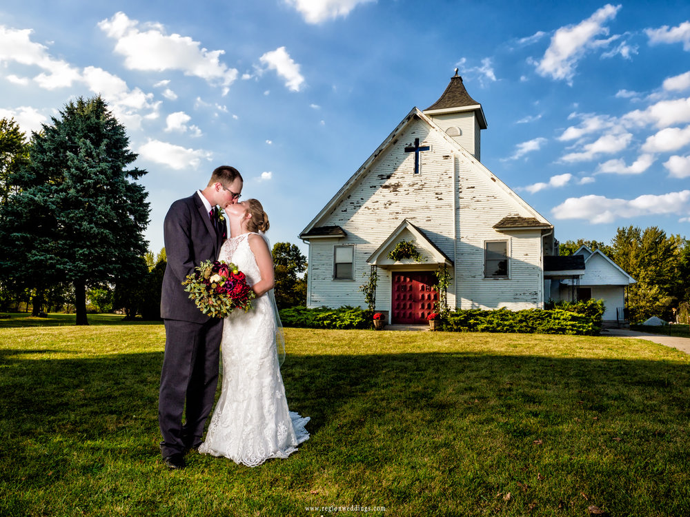 Bride and groom in front of her childhood church in Hebron, Indiana.