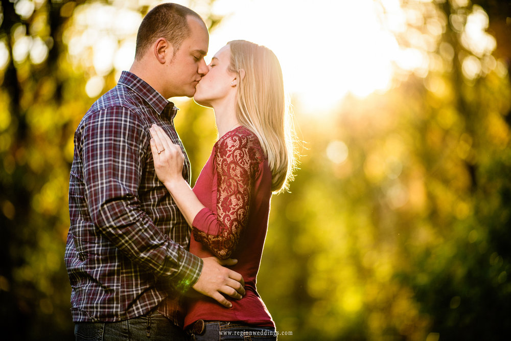 A golden light engulfs a young couple at Taltree Arboretum.