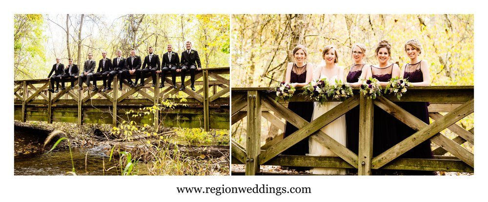 The groomsmen and bridesmaids on a bridge at Coffee Creek Nature Preserve.