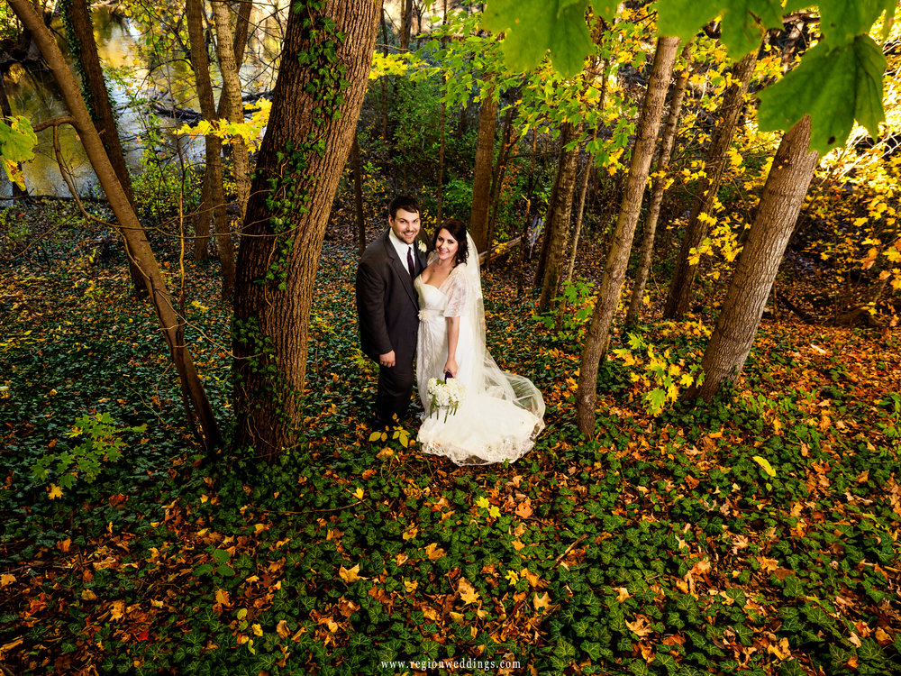 Bride and groom surrounded by Fall leaves in Porter, Indiana.