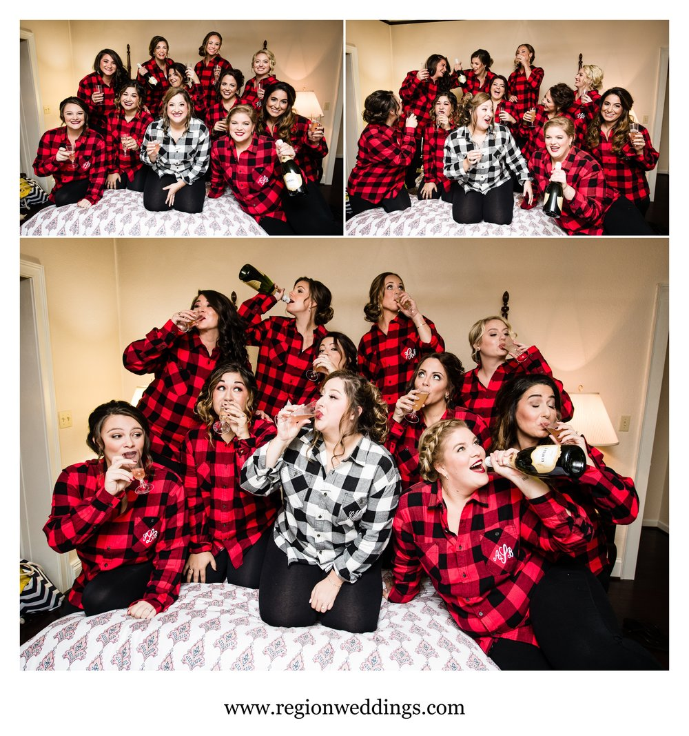 Bridesmaids in flannel shirts having fun on wedding day.