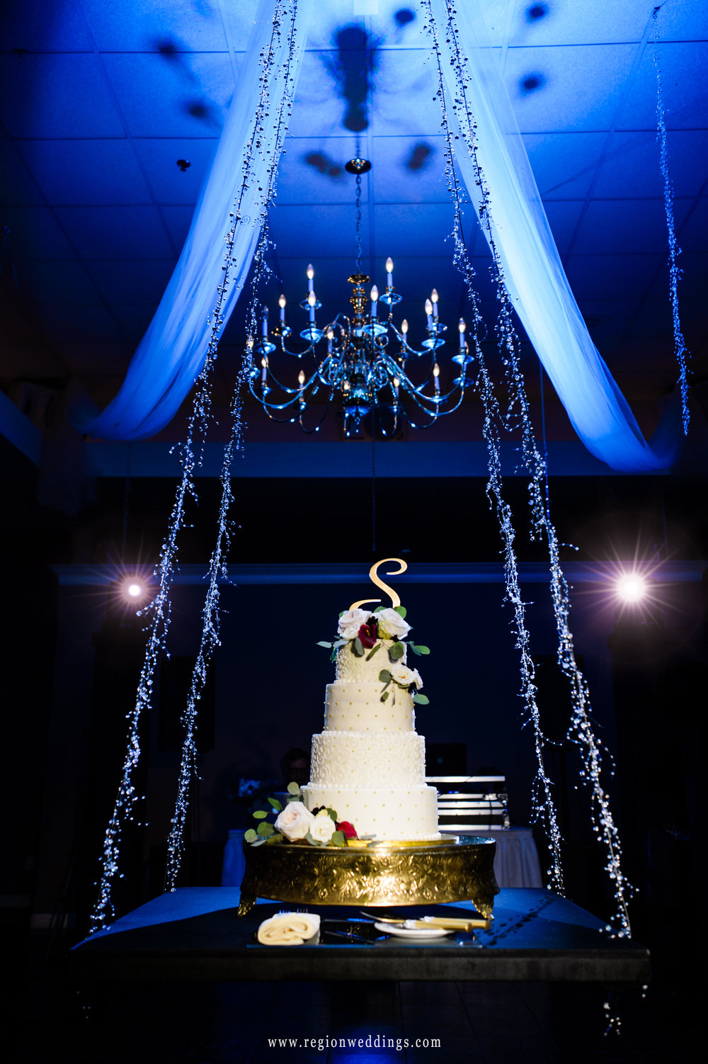A wedding cake is suspended from the ceiling at Aberdeen Manor.