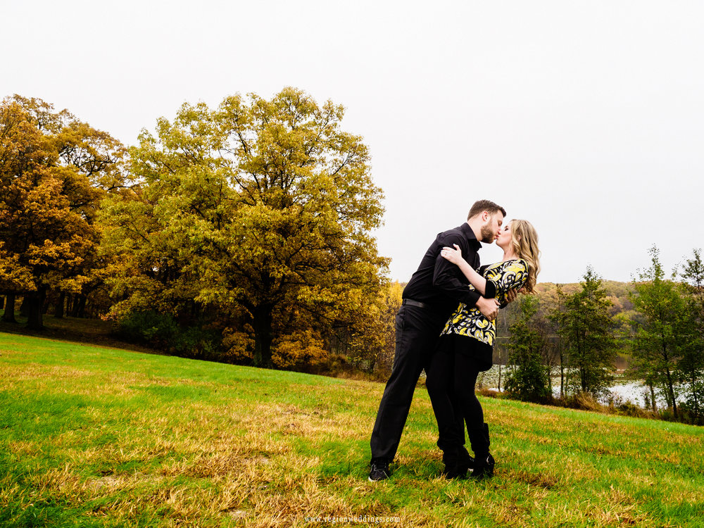 Romantic dip on a hill during a Fall engagement session.