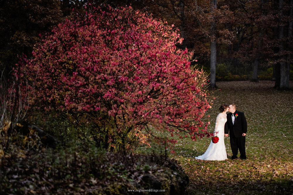 Red leaves illuminate at Lourde's Friary for a Fall wedding.