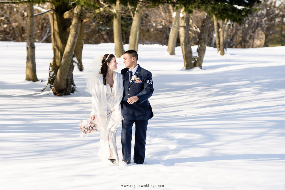A walk in the snow for the bride and groom at their winter wedding in Crown Point, Indiana.