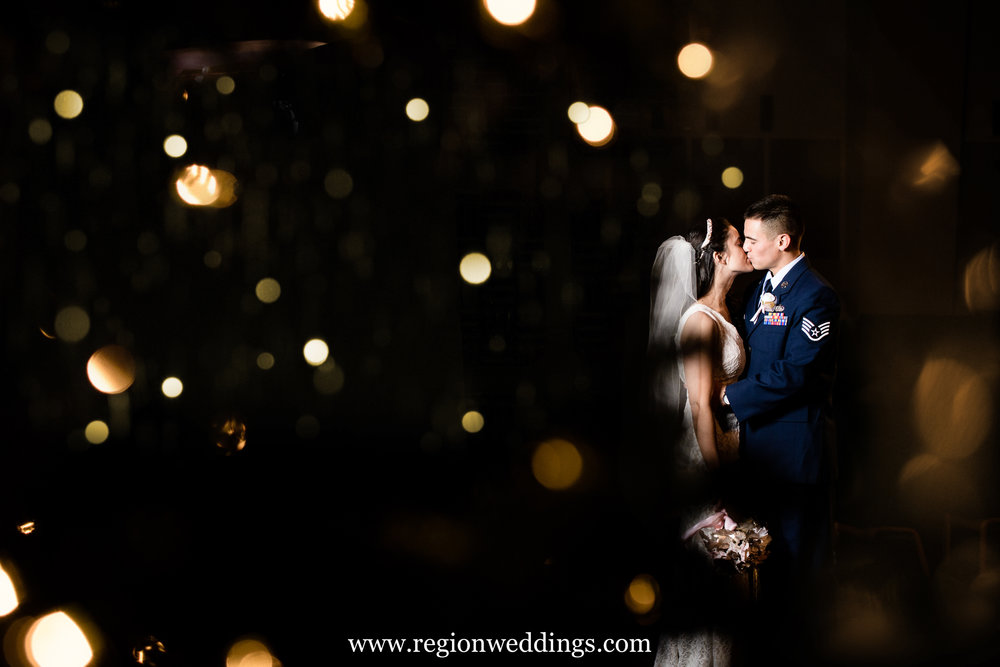 Two newlyweds captured among Christmas lights on their wedding day.