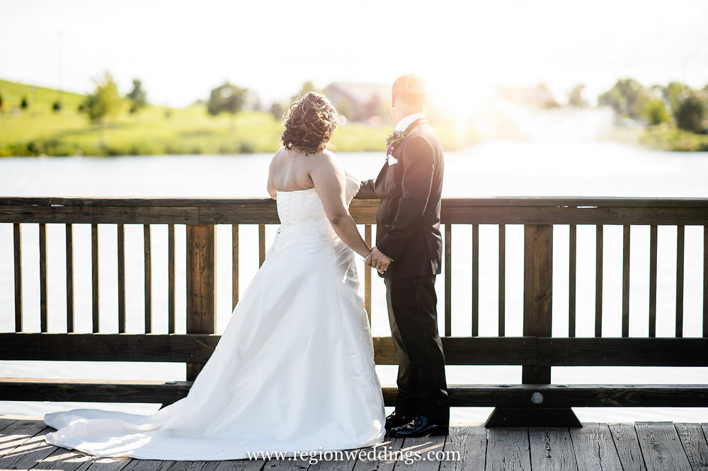 A newly married couple gazes across the Centennial Park bride as sun engulfs them.