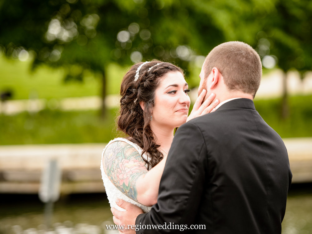 A couple have their first look / reveal overlooking the lake at Centennial Park.