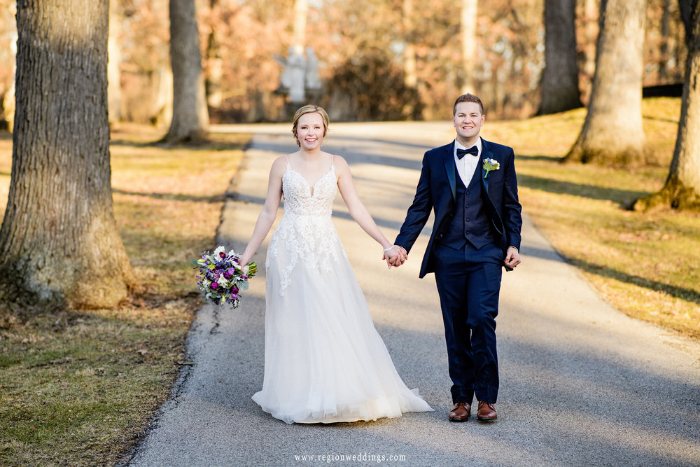 Bride and groom take a romantic walk after their wedding at Faith United Reform Church.
