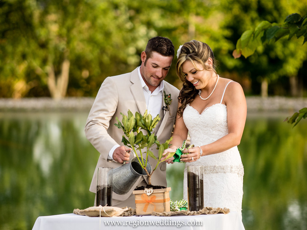 A ceremonial garden planting during an outdoor wedding at The Red Barn Experience.