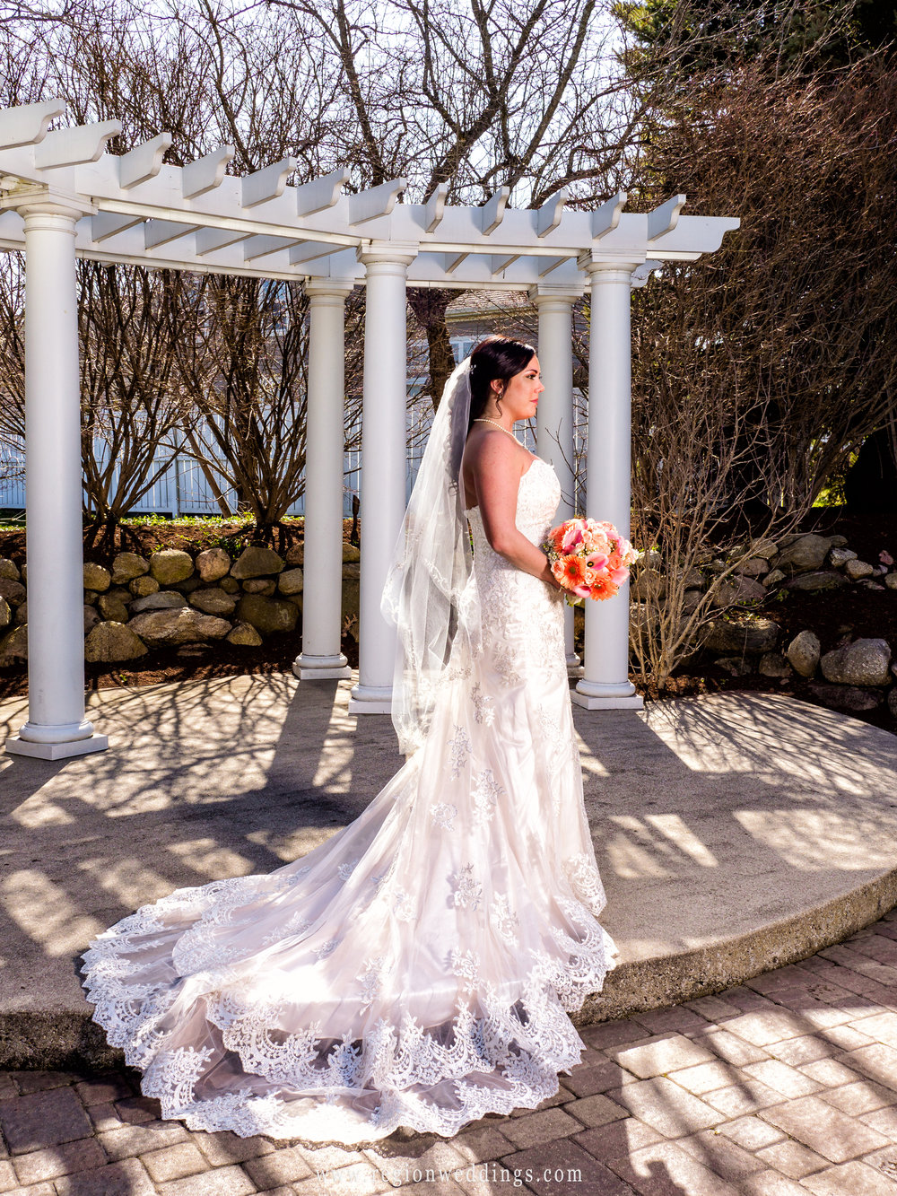 The beautiful bride in front of the gazebo at Aberdeen.