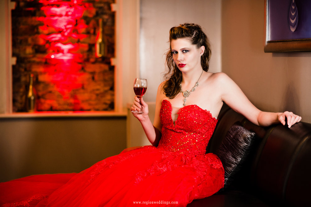 Red wine, red dress, red wall in the lounge at Uptown Center.