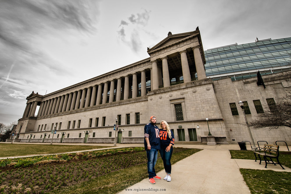 Engagement portrait in front of the columns of Soldier Field.