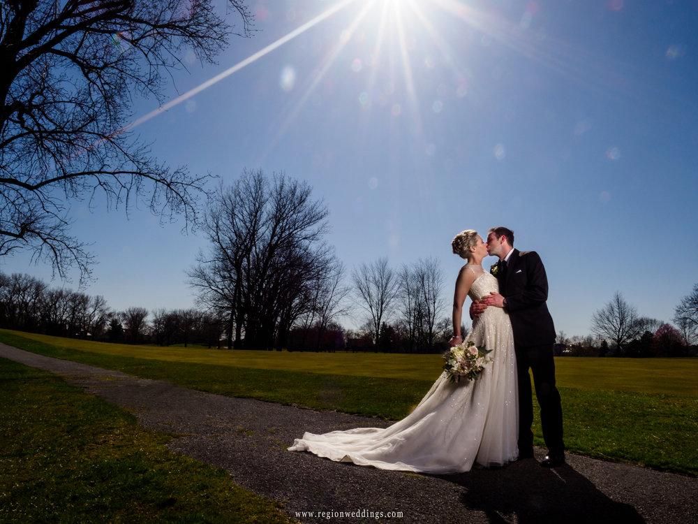 Bride and groom beneath a sun star at Briar Ridge Country Club.