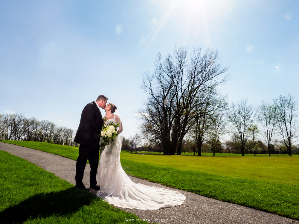 The sun shines down upon the bride and groom at Briar Ridge Country Club.