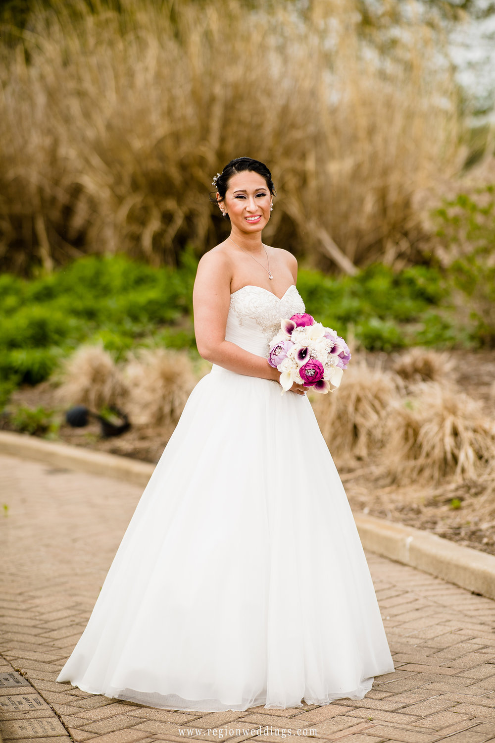 Portrait of the bride in the Sand Creek garden.