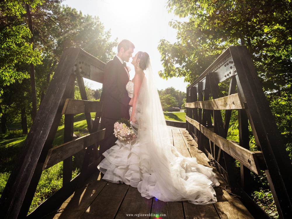 Bride and groom on the kissing bridge at Valparaiso University.