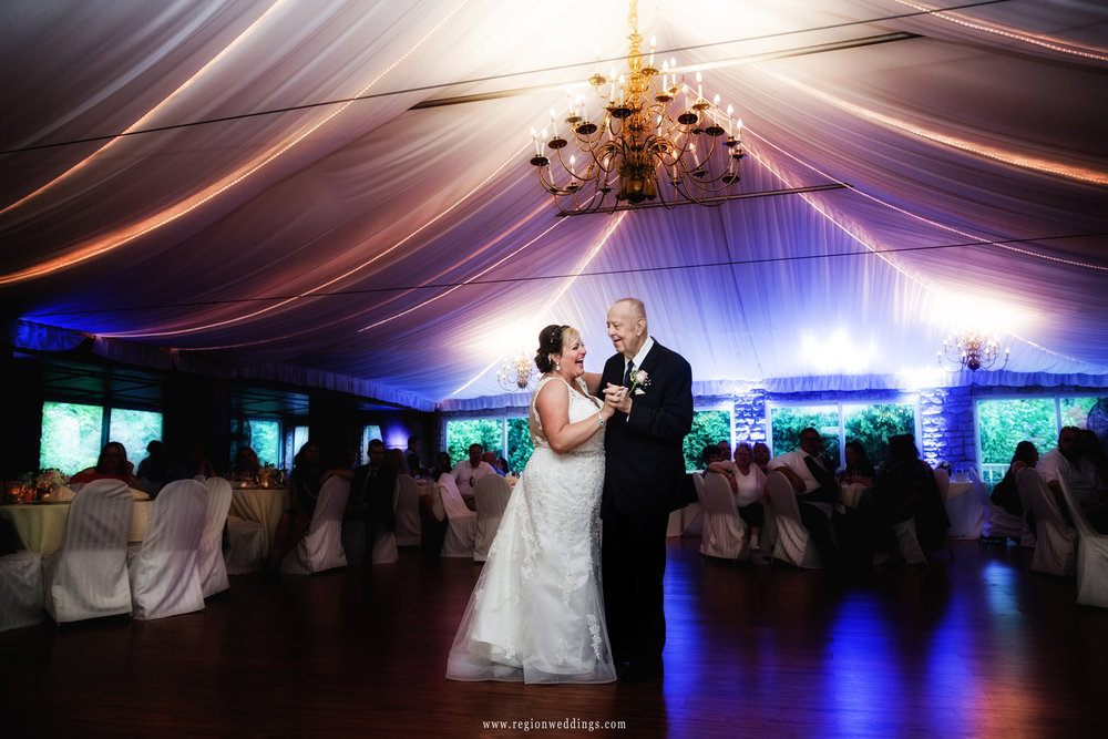 Father of the bride with his daughter during parent dances.