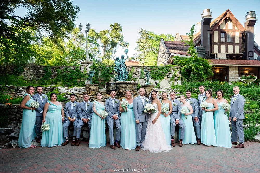 The wedding party in front of the castle fountain.