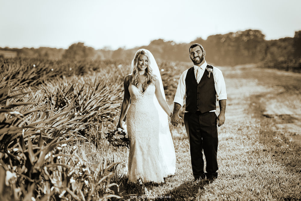 Bride and groom walk in the wilderness.