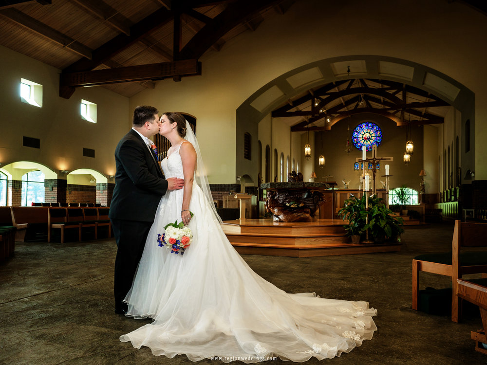 The newlyweds kiss at St. Michael's Parish in Schererville, Indiana.