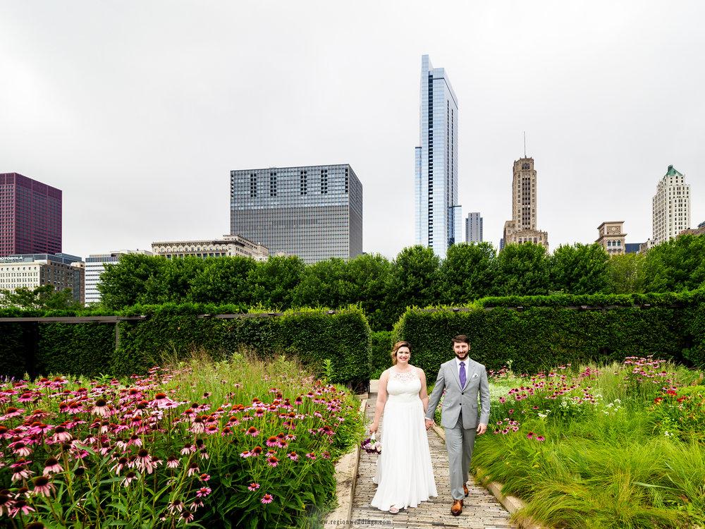 Bride and groom take a walk through Lurie Garden.