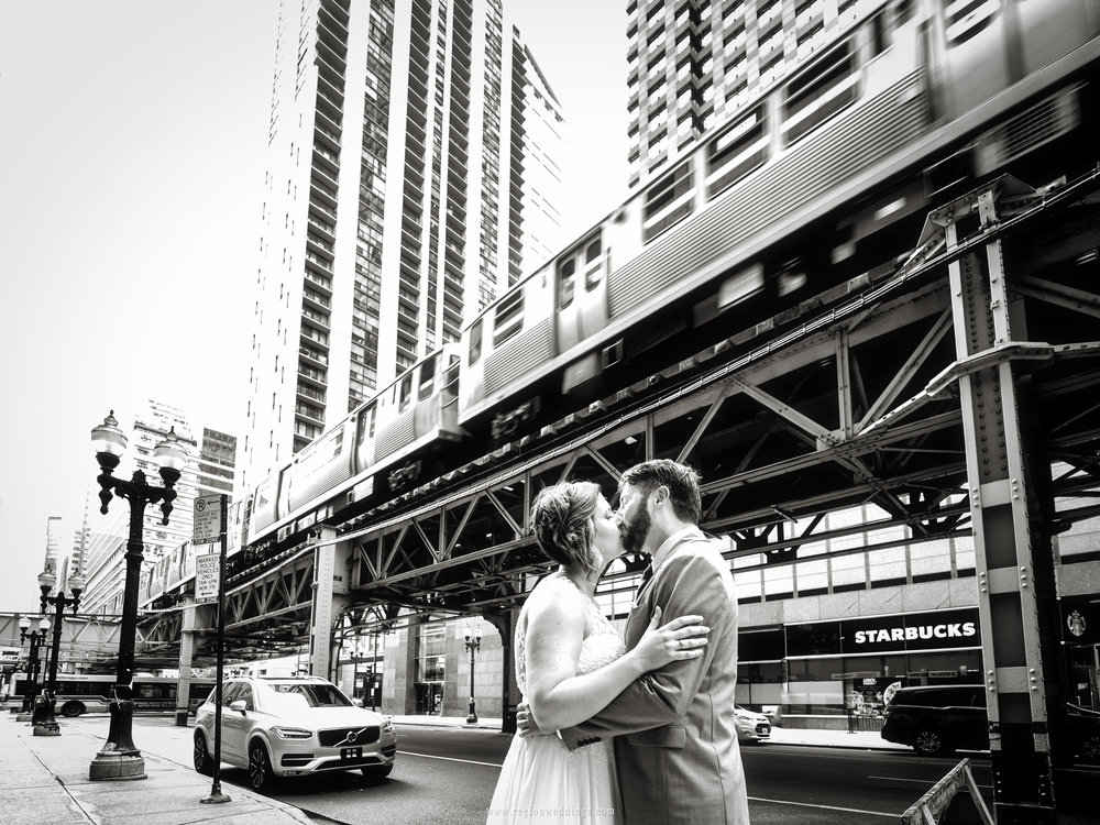 Romantic black and white wedding photo with the Chicago L train.