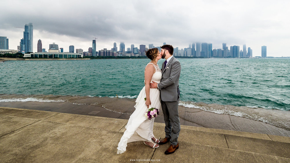 Clouds and fog accumulate over the city skyline for this Chicago wedding photo.
