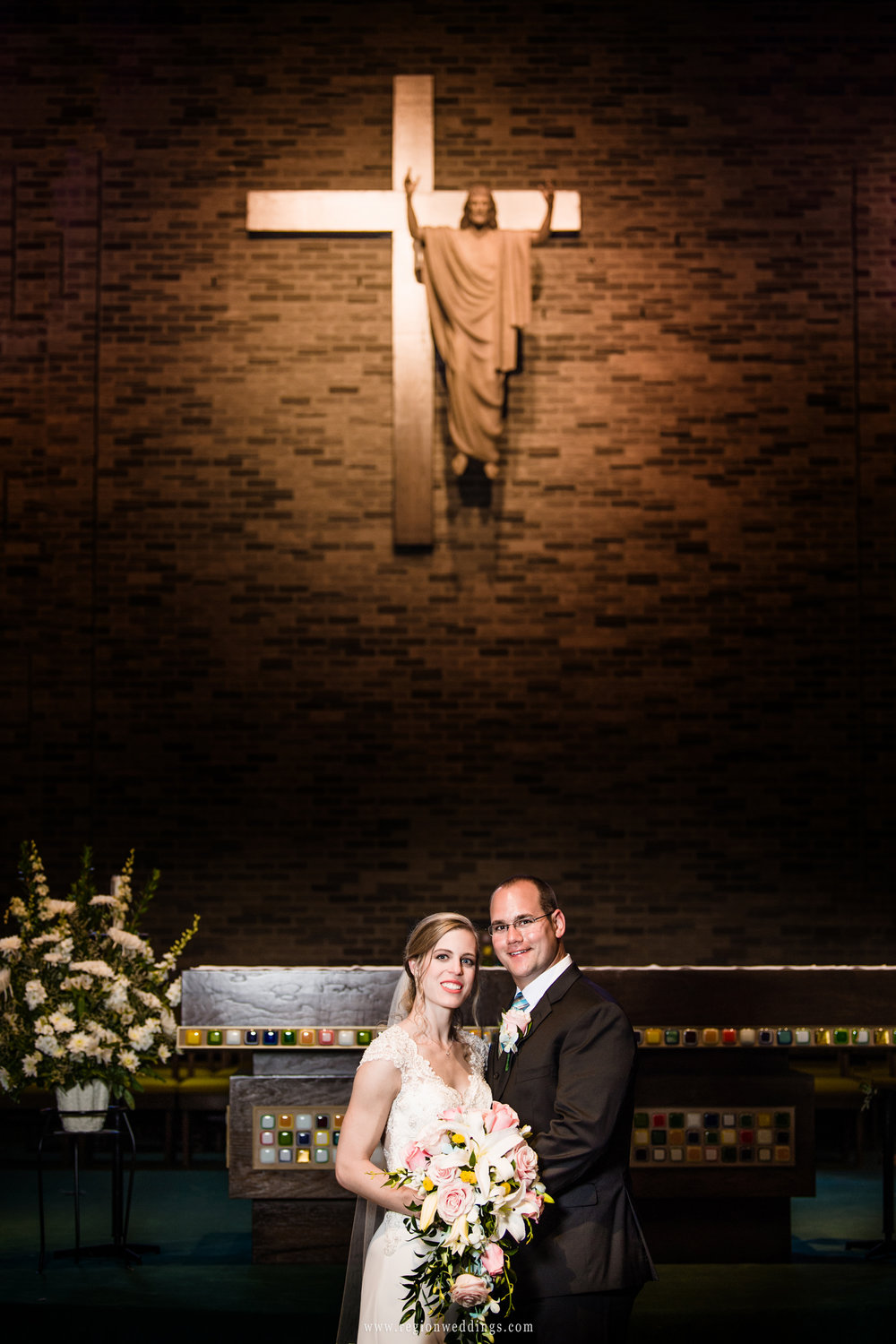 Bride and groom at the altar of St. Maria Goretti Church.
