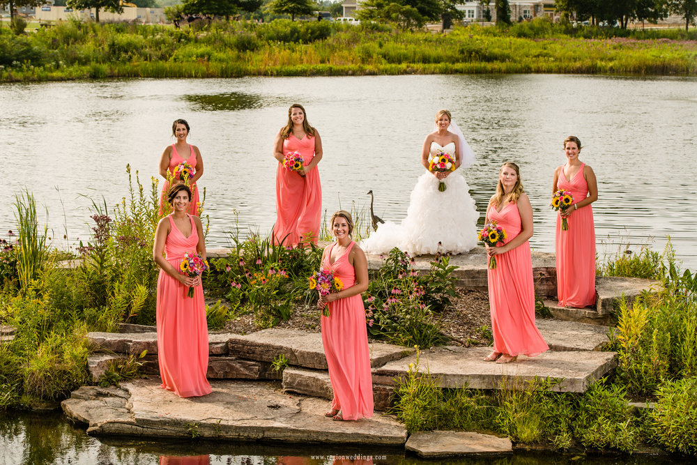 Bridesmaids on the rocks of the lake at Coffee Creek.