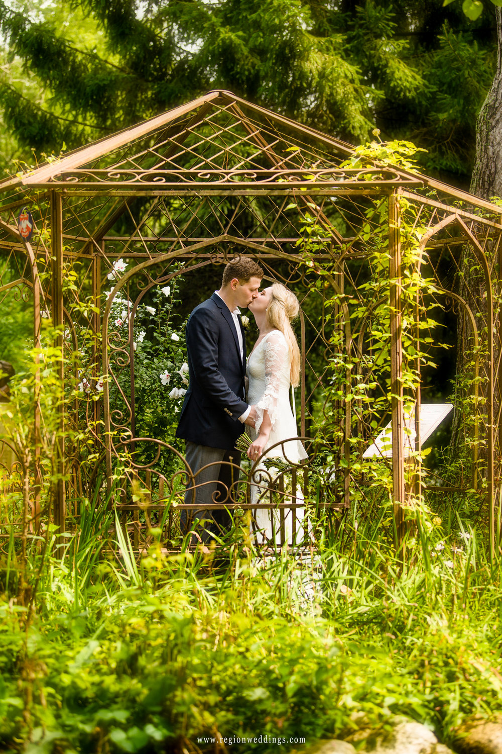 Kiss inside the gazebo.