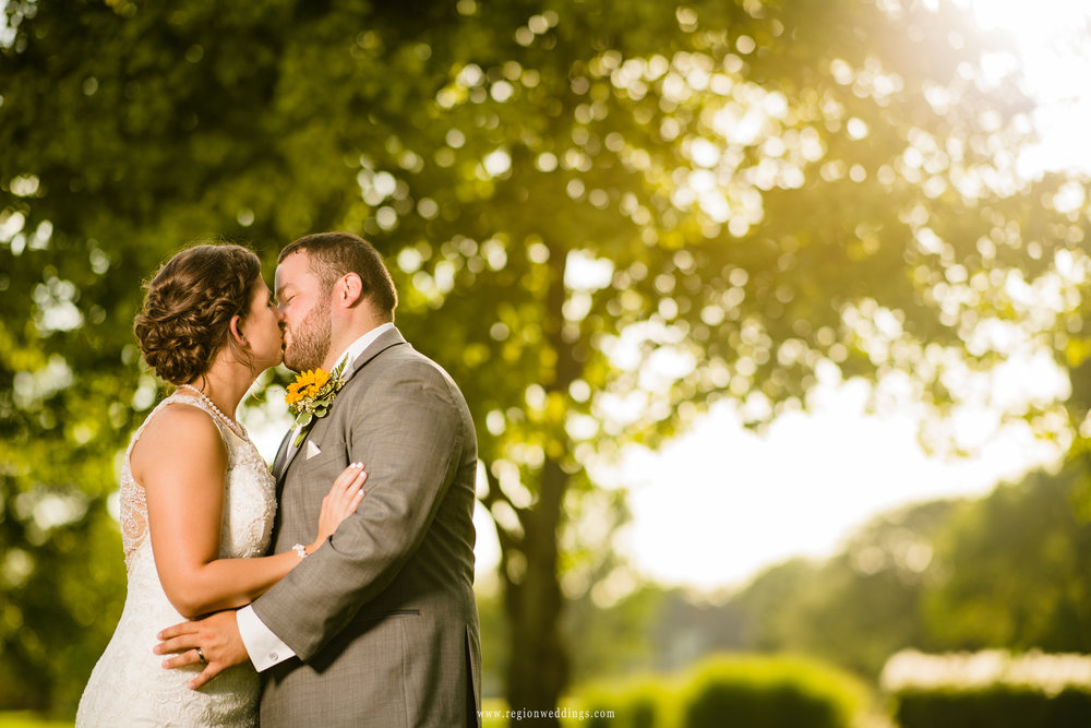 Golden sun streams through the trees for a romantic wedding picture at Briar Ridge.