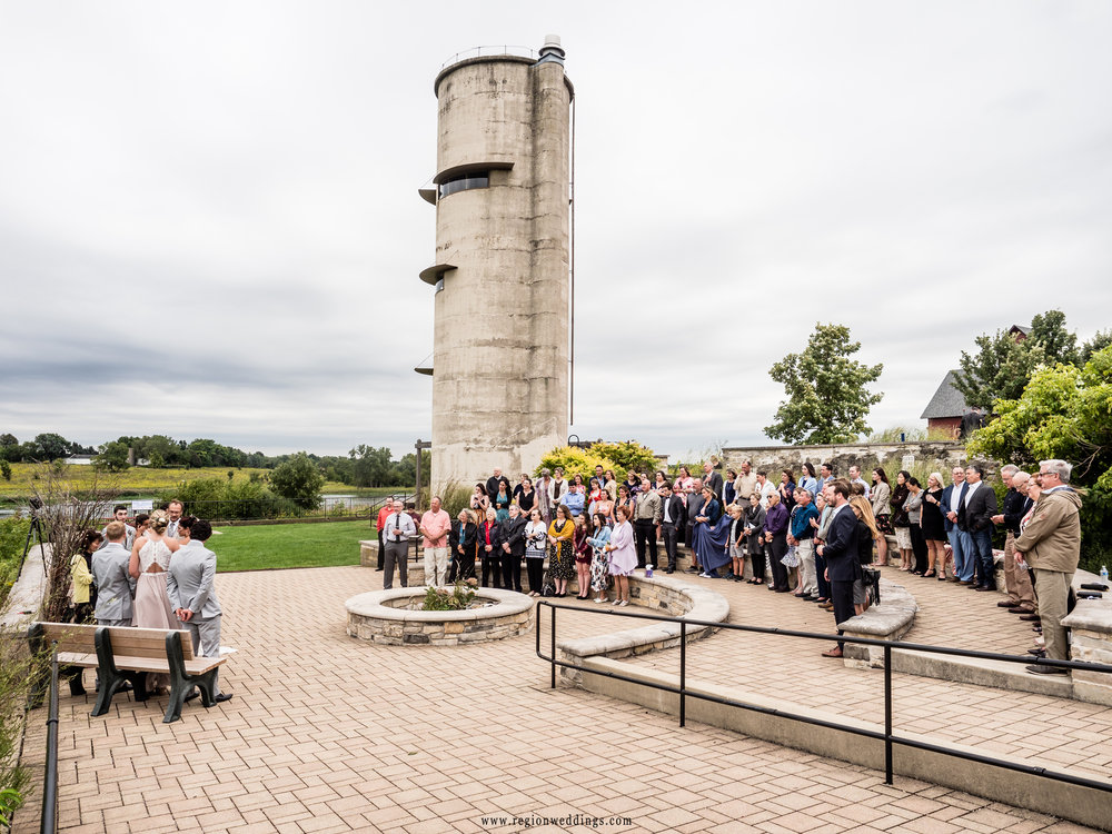 Wedding ceremony beneath the grain silo at Peck Farm Park.