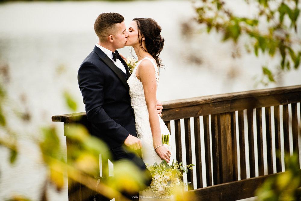 Romantic kiss on the bridge at Centennial Park.