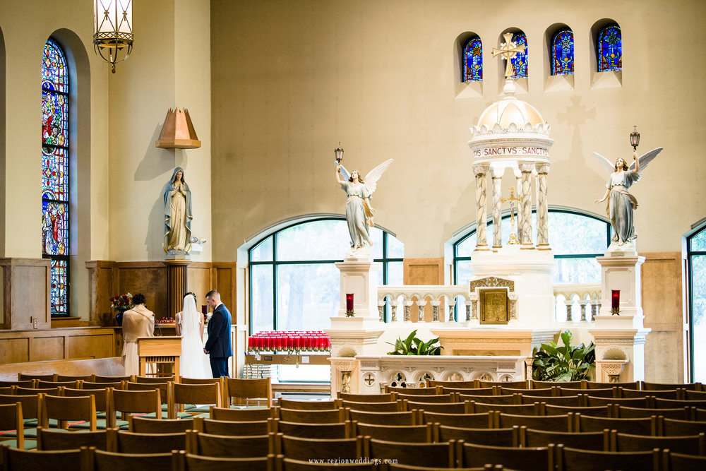 Bride and groom in the sanctuary of St. Michael's Parish.