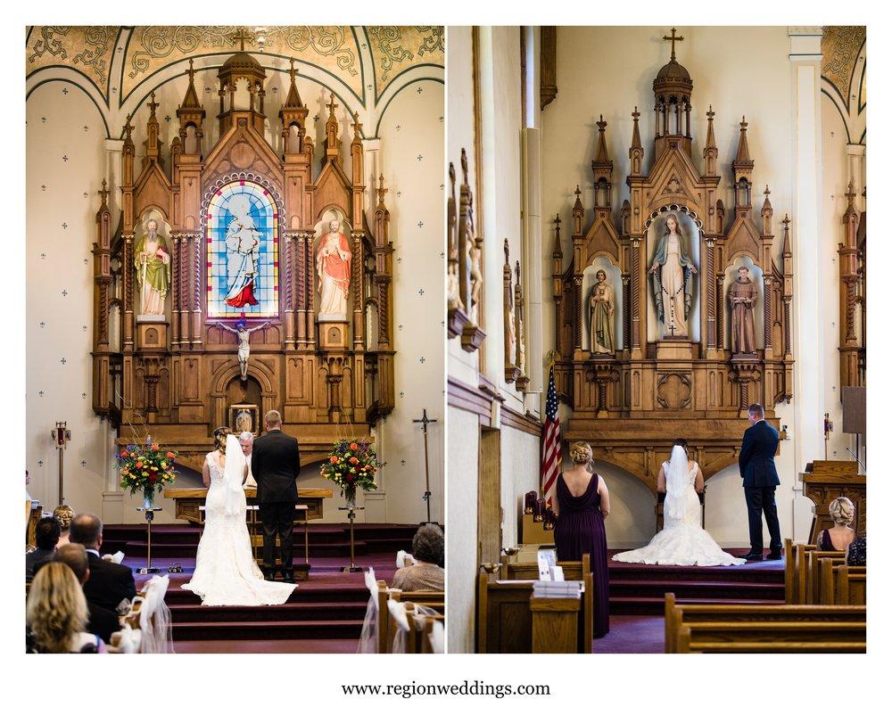 The bride and groom pray at St. Mary Catholic Church.