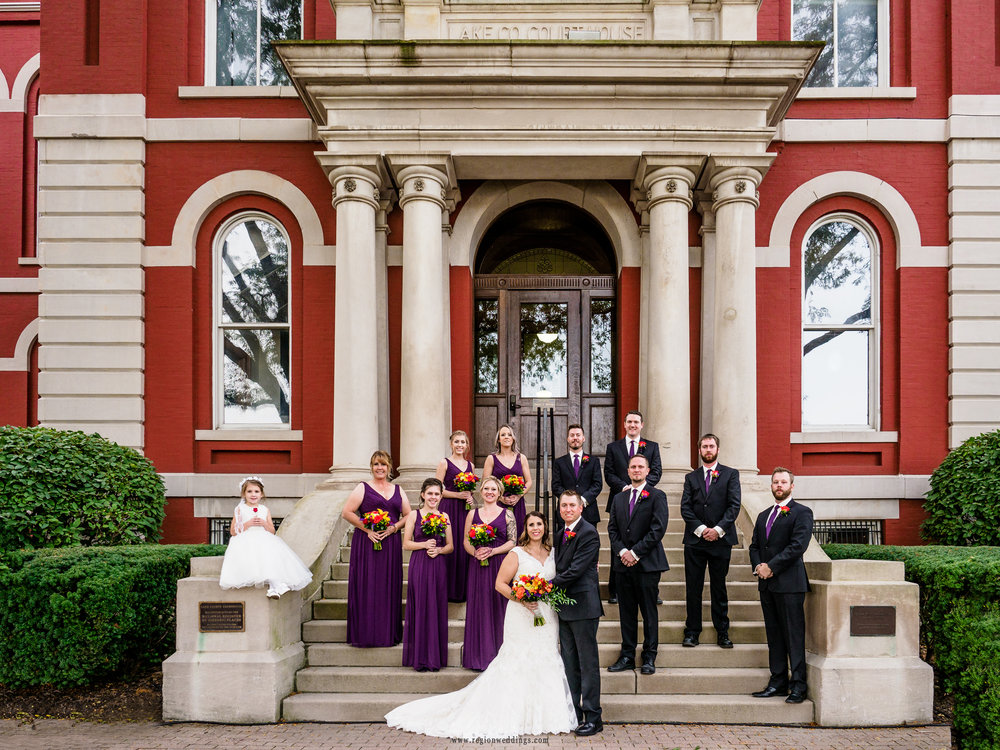 Wedding party group photo on the stairs to the old Crown Point Courthouse.